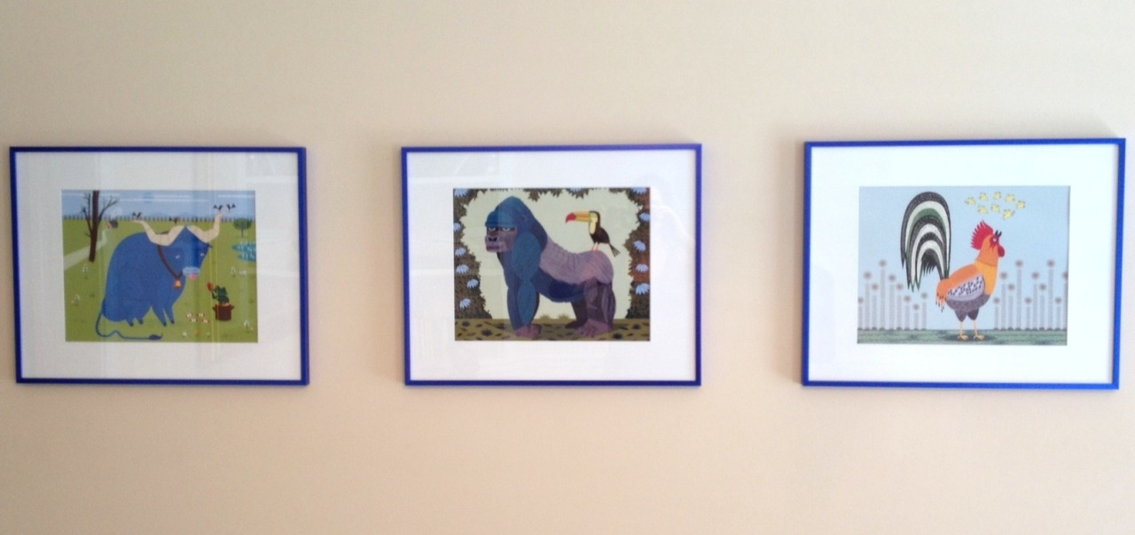 Prints in blue frames.  Prints available here:  https://www.etsy.com/shop/iotaillustration