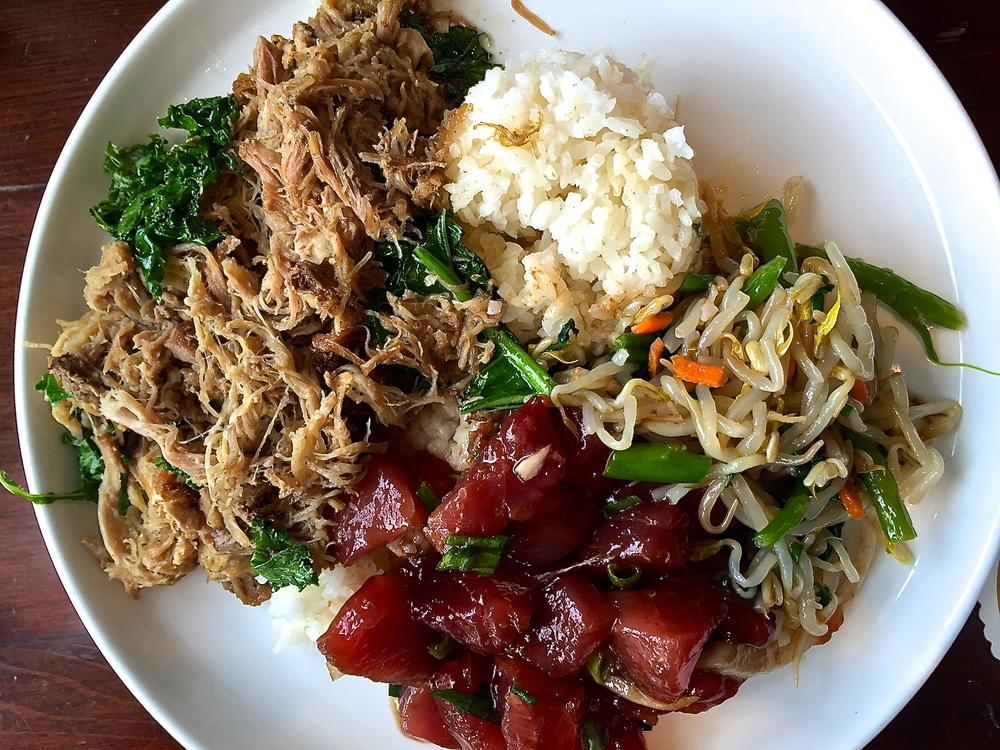 Kalua pig with poke tuna, stir fried vegetables.