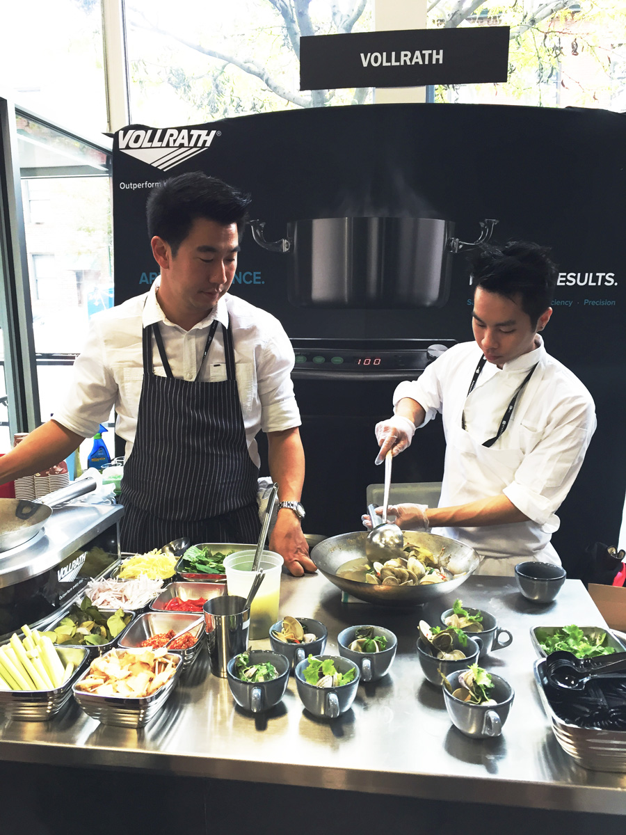 Angus An of Maenam  , Vancouver doing a little clam stir-fry at the Vollrath booth.