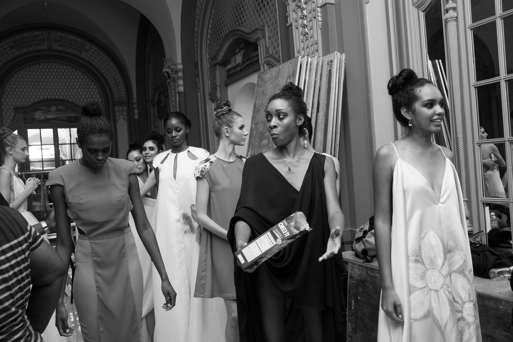 """Who says """"models don't eat!""""? All evidence to the contrary. But is the best time to really eat while in line up about to walk in expensive dresses necessary?"""