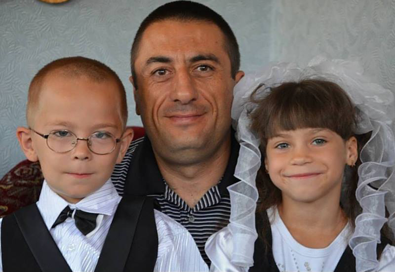 Evgeniy with two of his children.