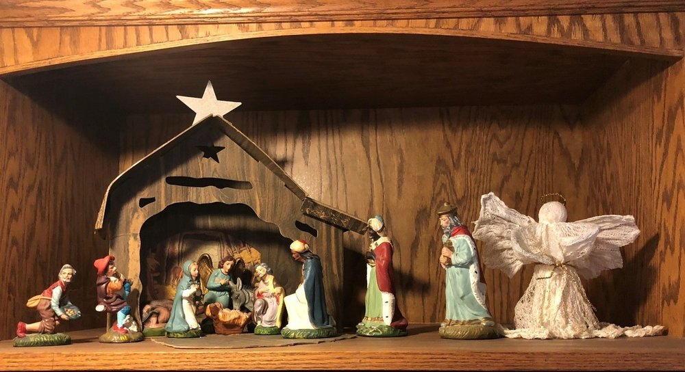 Yes, this is a picture of the Nativity set (the hay disappeared from the manger over the years and the Christmas star has lost its glitter). The white angel to the right was made years later by our youngest son.
