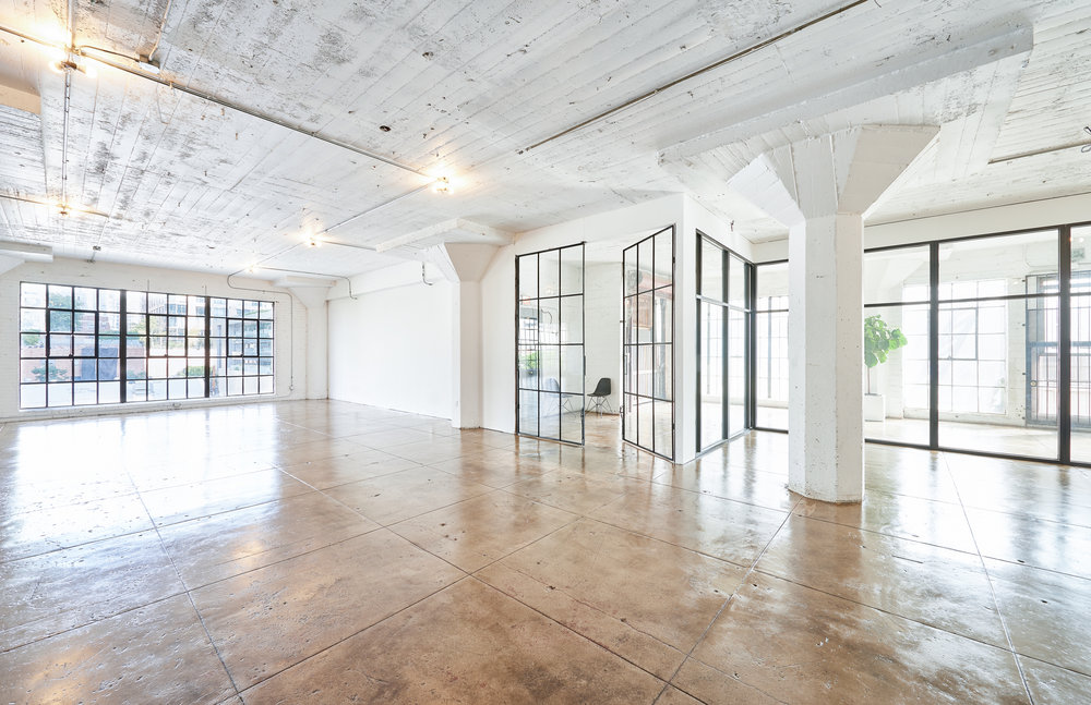 3RD FLOOR: CORNER LOFT - 2,000 sq ft12' ceilingswindows face N & Evehicle access
