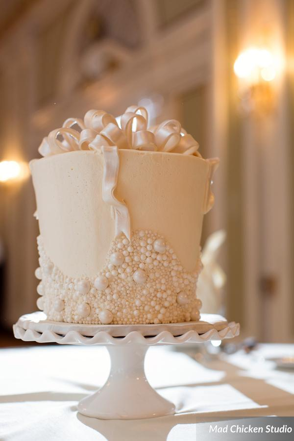 This wedding had one of the coolest cakes we have ever seen! We can forgive the fact that there weren't flowers on it ;) See more scrumptious goodies from How Sweet It Is Cakes here.
