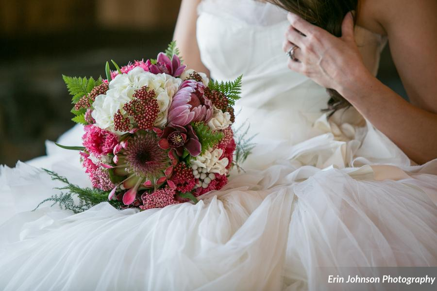 The bridal bouquet featured protea, white hydrangea, yarrow, silver brunia, tulips, lace fern, & plumosa - what a stunner!