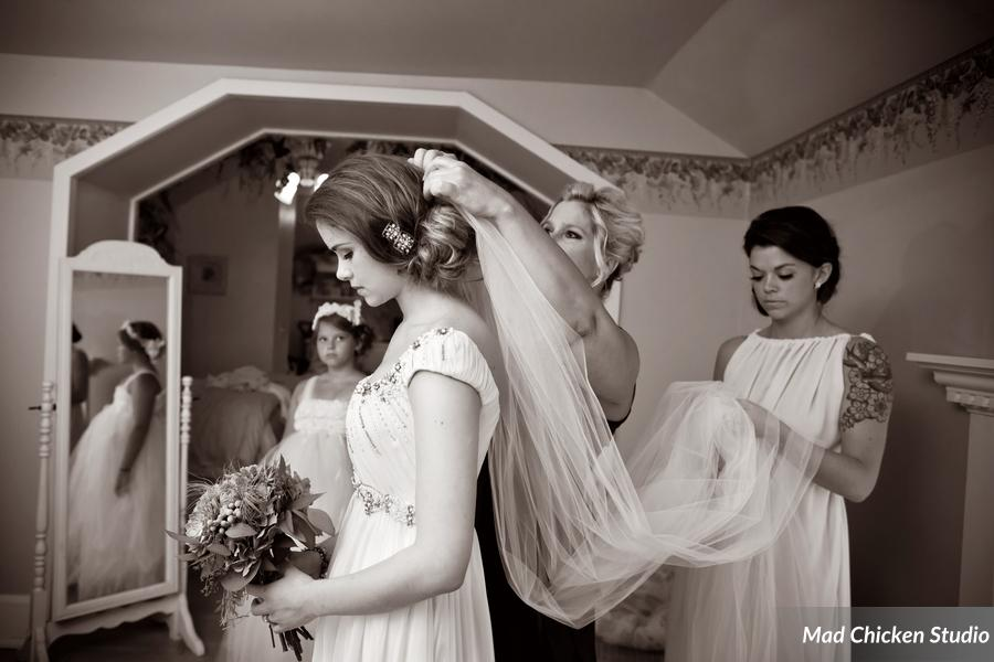 They primped and prepped at Duluth's stately Cotton Mansion. The obvious choice for makeup artistry? Derick Cich. Duh ;) Side note: would you get a load of the veil? Whoa!