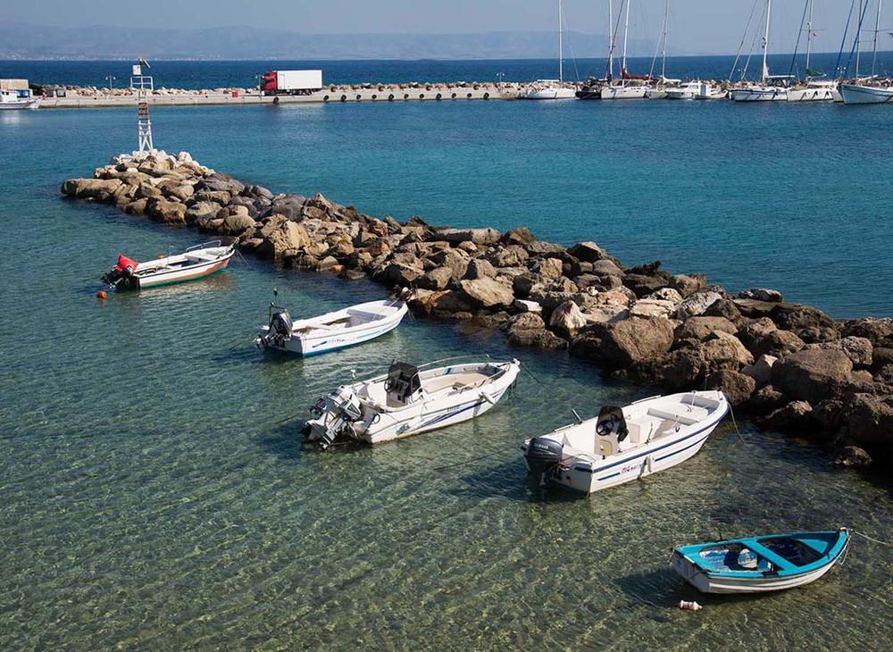 Boats docked inthe Piso Lavadi harbor, Paros