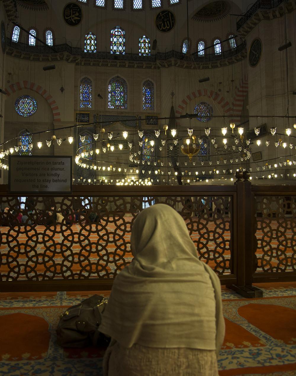Woman worshipping at the Süleymaniye Camii, Istanbul