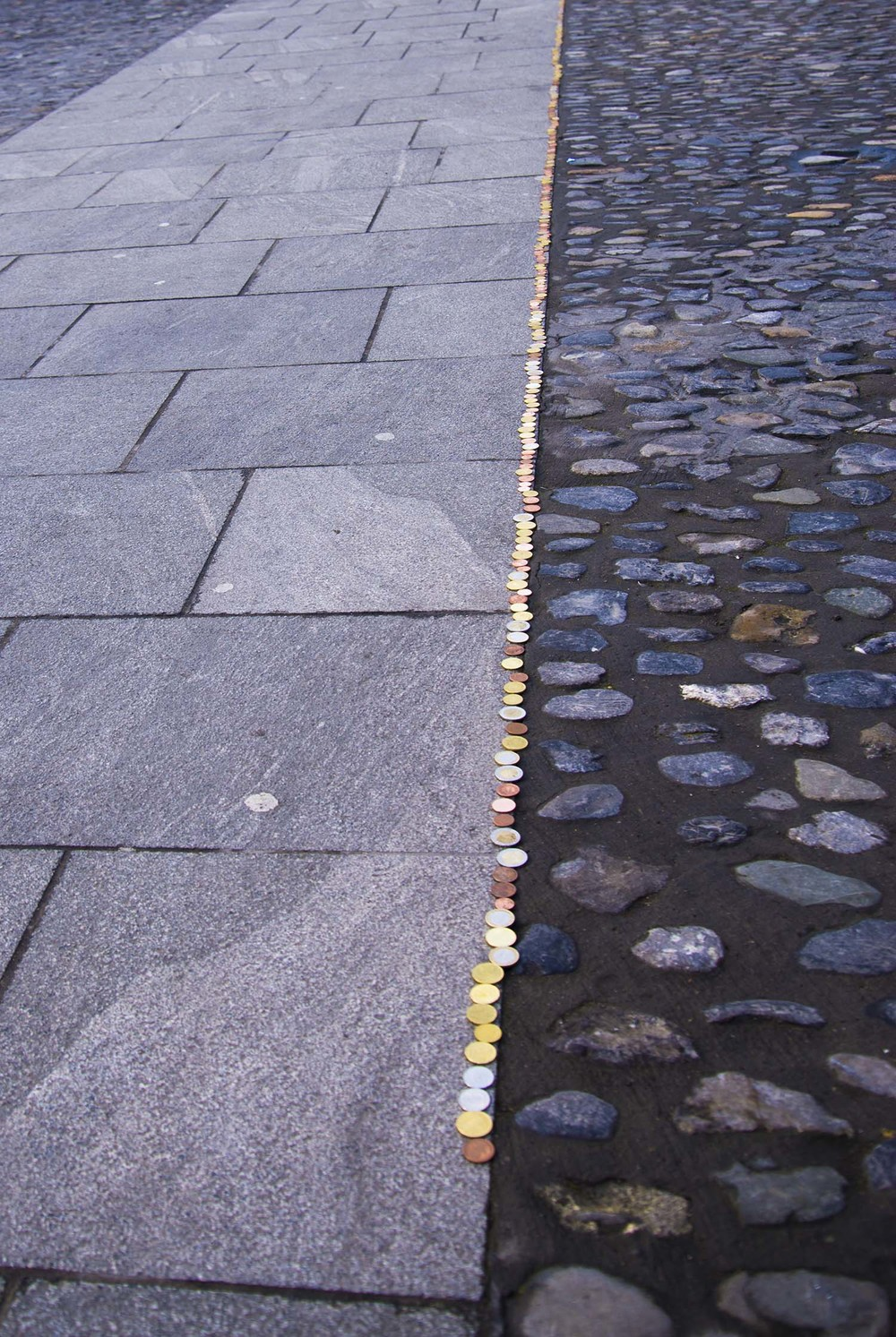 A line of coins for charity, Trinity College, Dublin