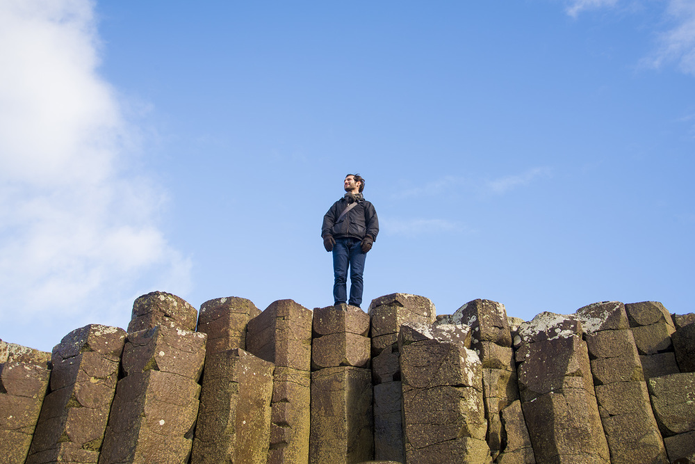 Michael on top of the rock formations at Giant's Causeway, Northern Ireland