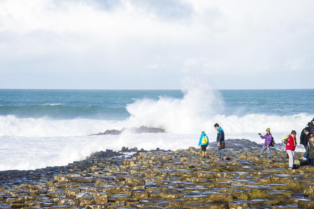 Tourists exploring the Causeway Coast, Northern Ireland
