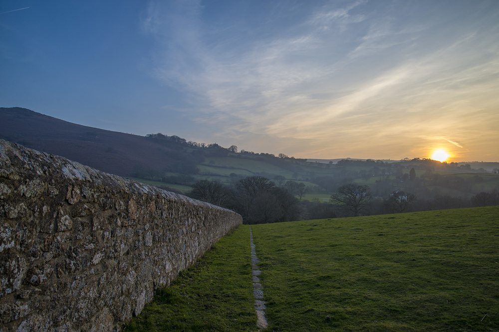 Stone wall and sunset from Chagford, Devon, UK