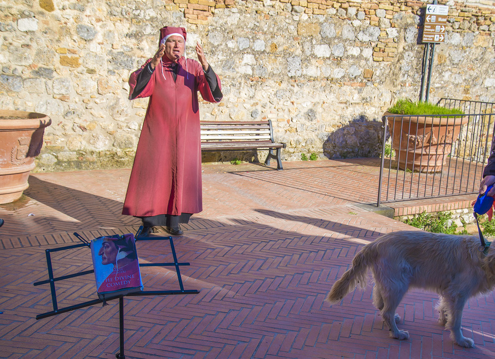 An actor performing a scene from Dante's Divine Comedy, San Gimignano, Tuscany
