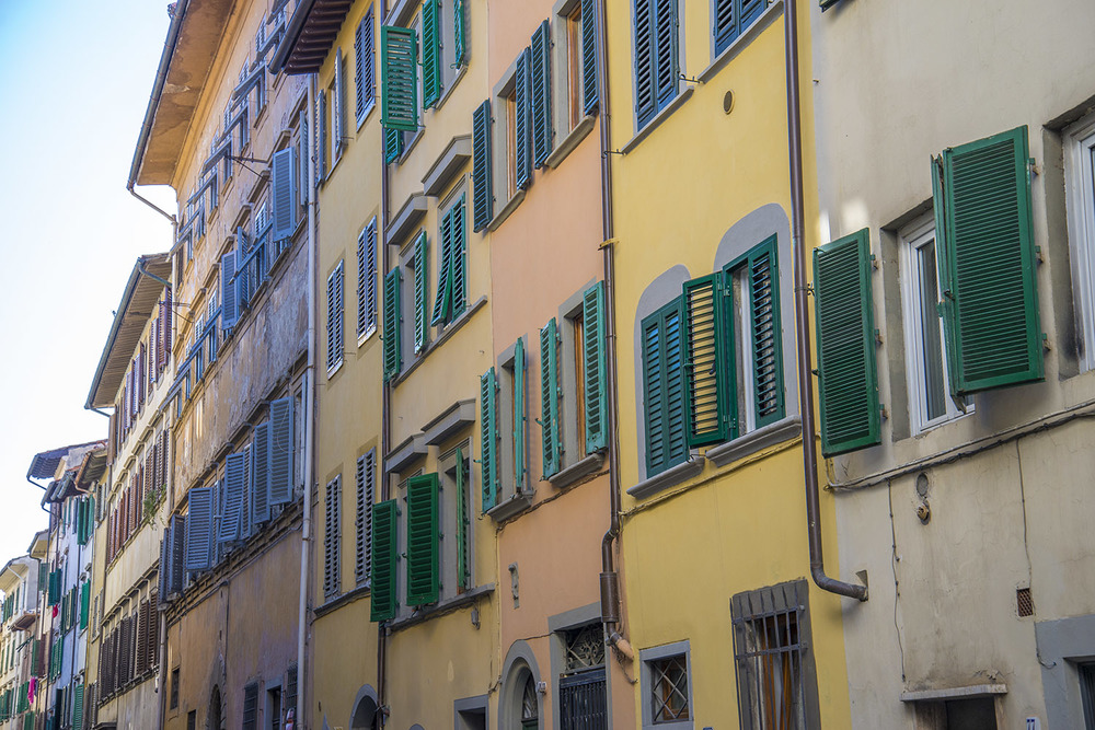 A row of shutters in the center of Firenze, Tuscany