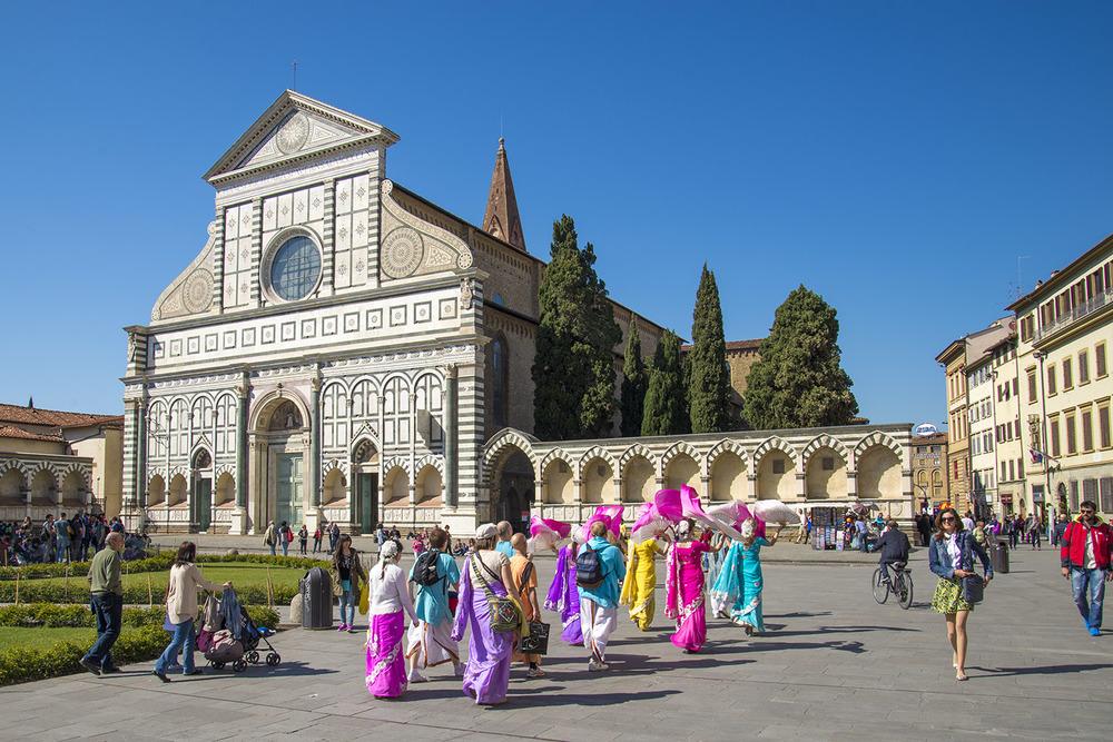 Hare Krishna group parading through the Piazza Santa Maria Novella, Firenze Tuscany