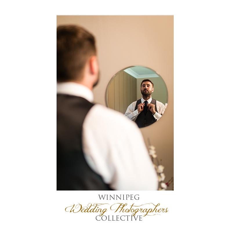 2 Groom getting ready mirror.jpg