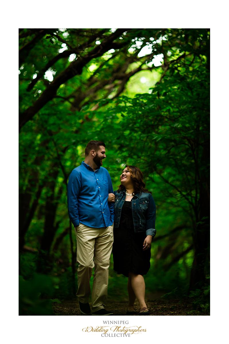 2 Walking through the forest engaged engagement shoot winnipeg Tony.jpg