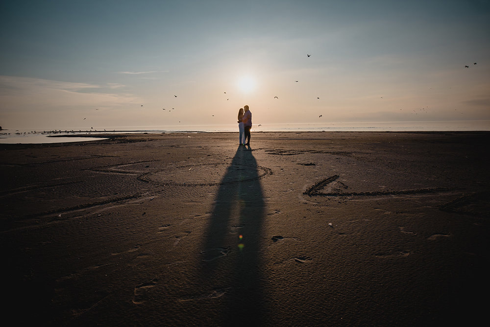 Sunset Engagement Photo at Grand Beach  by Cheryl