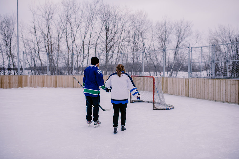 0010jensen-winnipeg-backyard-engagement-skating.jpg