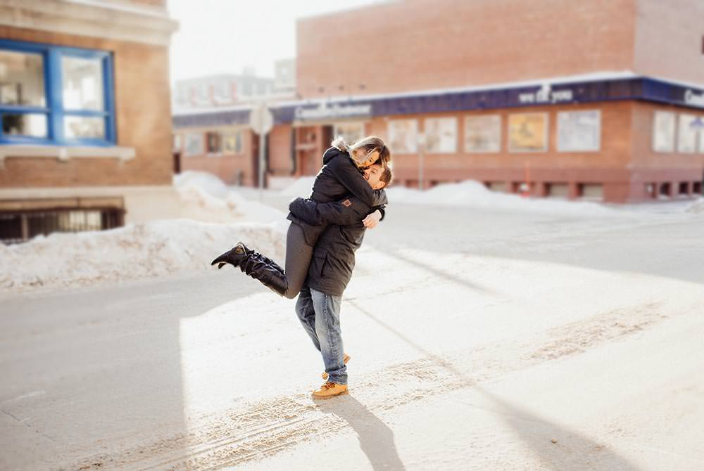 Winter engagement photo Winnipeg exchange district