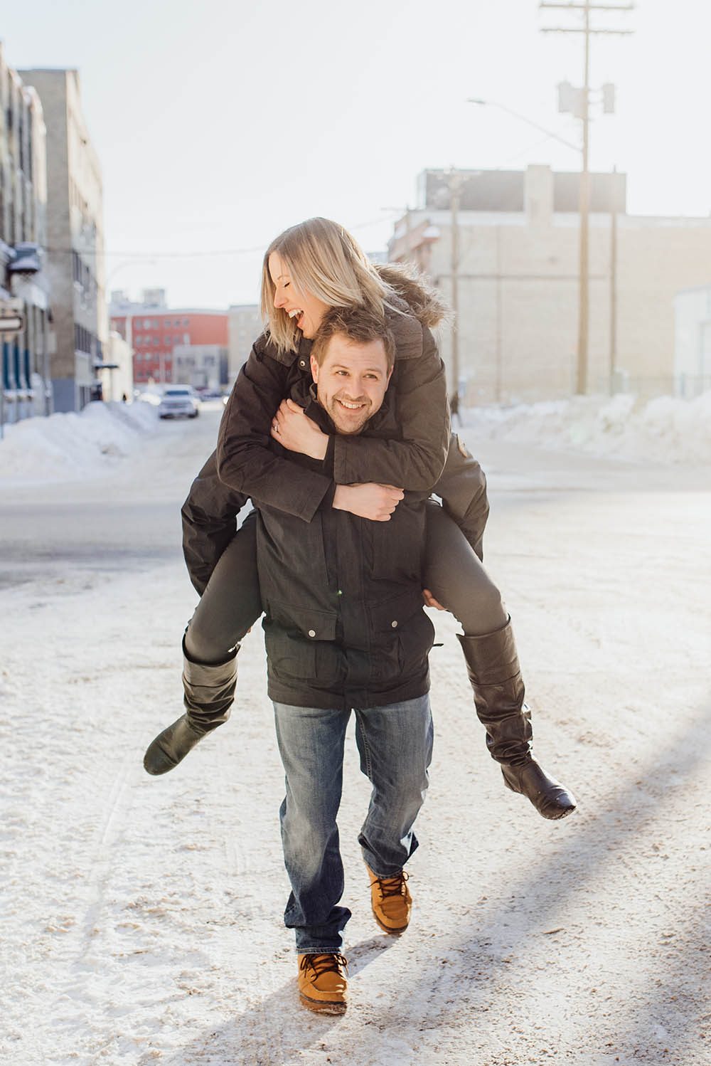 Fun piggy back engagement photo Winnipeg