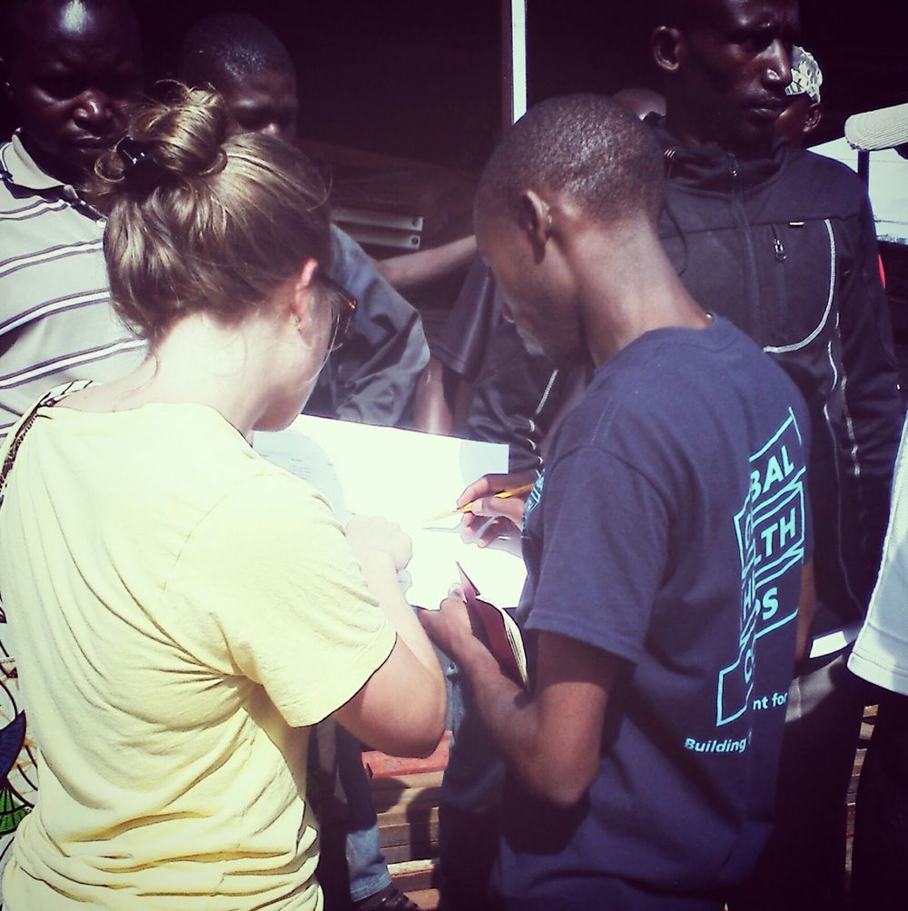 Meg and JP, Global Health Corp Fellows 2014-2015, procuring oven supplies in Kigali.