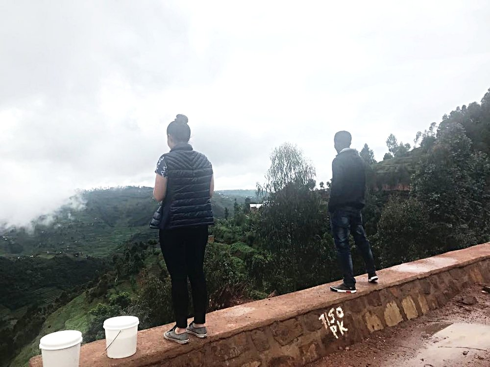 Julie and Aime on a recent site visit to TWB's upcoming bakery site in Gicumbi, Rwanda.