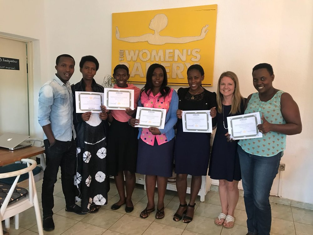 august 2018 - At the end of the program, all trainees passed the exam with over 90% accuracy, demonstrating a strong ability to learn and apply their knowledge to future managerial endeavors.Hilary (second from right) and Aimé (far left) were a big part of the training program. Hilary helped design the curriculum, and Aimé delivered the training on-site.
