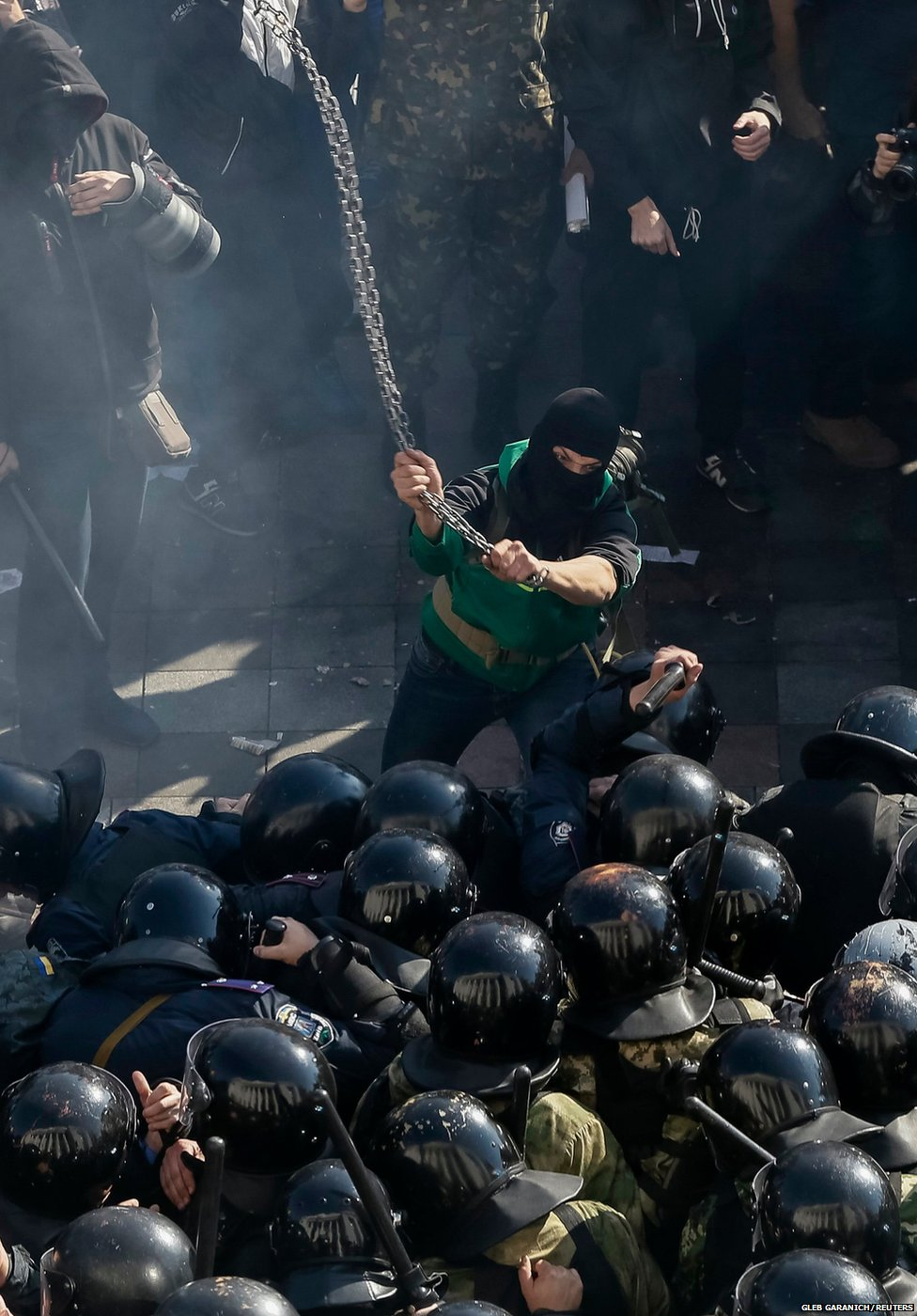 In Kiev, Ukraine, nationalists confront riot police. Photo courtesy of Gleb Garanich/Reuters.
