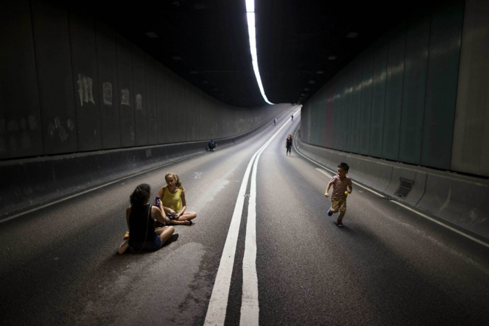 Pro-democracy protestors block traffic from this tunnel in Hong Kong. Photo courtesy of Tyrone Siu/Reuters.