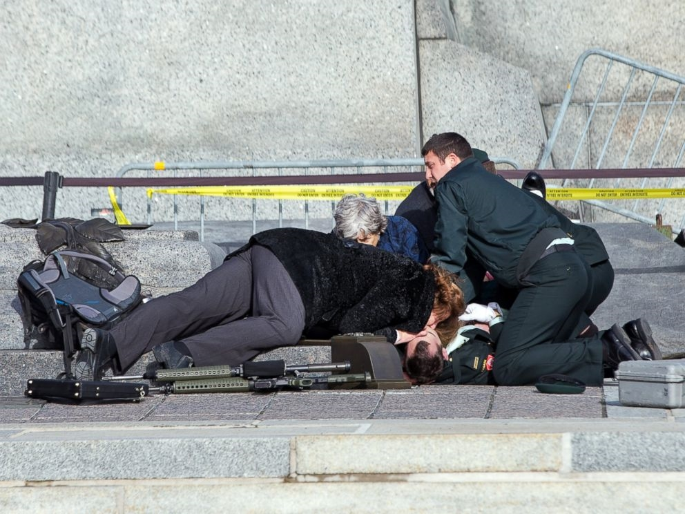 In Ottawa, Canada, an emergency response team attempts to resuscitate a security worker on the Parliament grounds following a shooting. Wayne Cuddington/Barcroft Media /Landov