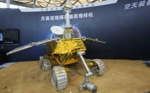 Chinese aeronautics engineers display the Jade Rabbit, a probe prepared for a December launch into space. Shanghai Daily via AP