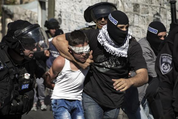 Israeli police apprehending a child following Friday prayers in East Jerusalem. REUTERS/Finbarr O'Reilly