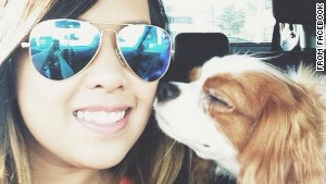 "Nina Pham, Dallas nurse who was recently cleared of ebola, reunites with her dog. She describes the experience as ""like Christmas morning."" Source: CNN"