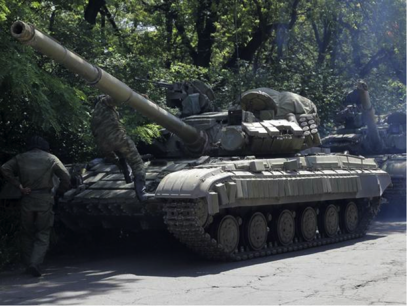 "Ukraine claims that ""dozens of tanks and truckloads of soldiers"" have crossed the Russian border into their territory. Source: The Independent."