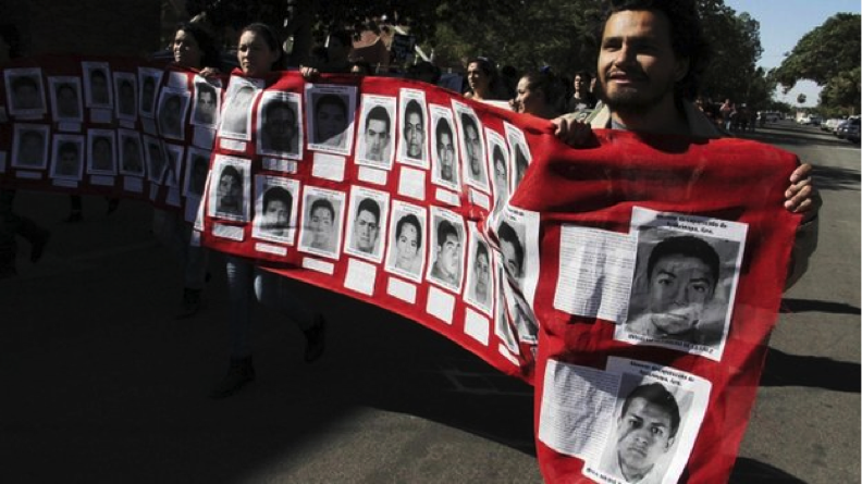 Civilians mourn the 40 Mexican students who went missing following a clash with the police on September 23rd; now, suspected Mexican gang members have admitted to killing them. Source: BBC.