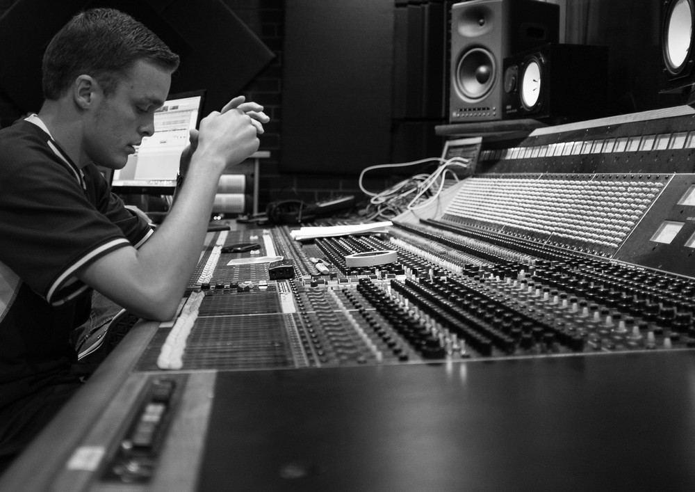 Deep in thought while listening to a verse that was just cut.