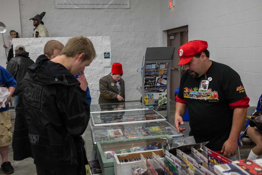 The wheeling and dealing going on at one of the toy and comic vender booths.