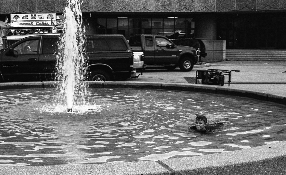 Someone enjoying the fountains outside of Century 2.