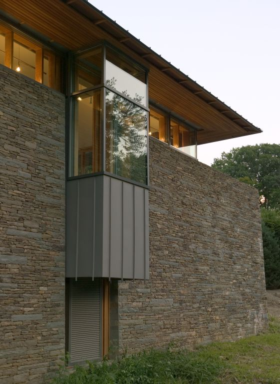 glass enclosed balcony stone wall