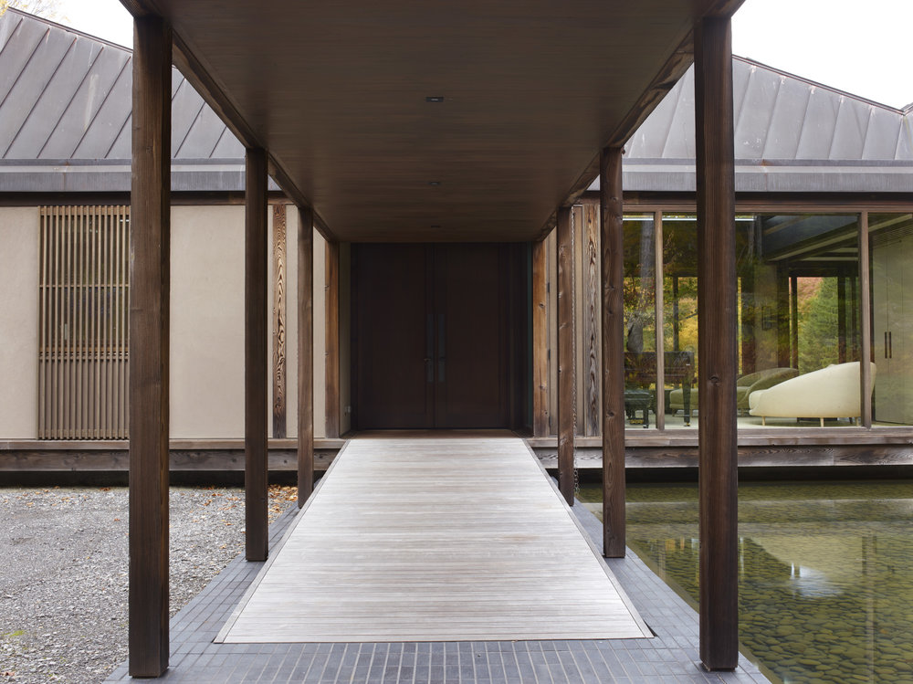 Exposed timber entrance of japanese inspired modern house