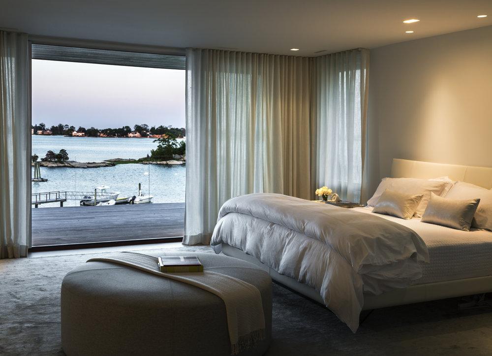 comfortable luxury bedroom waterfront views