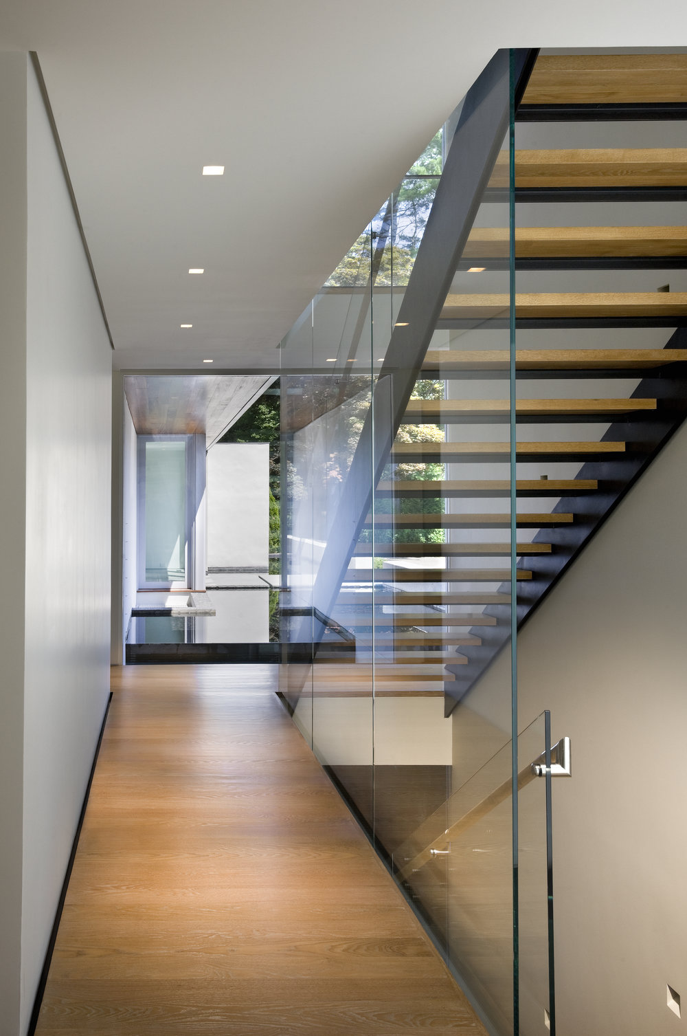 glass walled wooden staircase steel