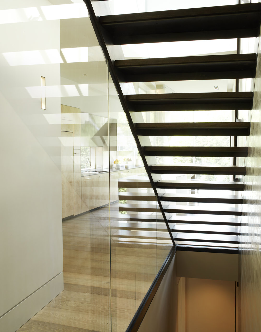 glass staircase wall with lighting