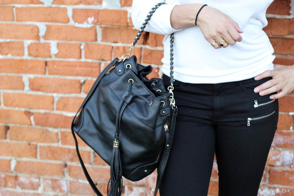 This DSW bucket bag is actually a new addition to my wardrobe! I love how versatile it is in terms of how you can wear it. I can hold it around my arm as seen in the picture, or I can even use it as a cross-body/over the shoulder bag. Not too mention its gold accents that match the rest of my jewelry! The neutral black color matches with a lot of different outfits, which allows for good use of it in the long term.