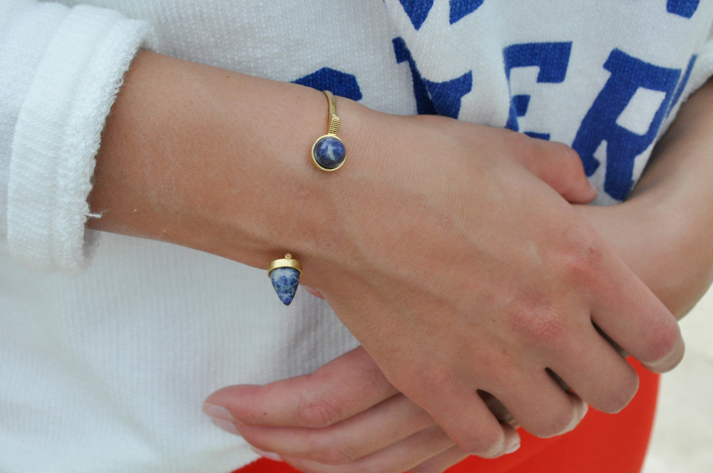 Madewell has created a great line of jewelry that is effectively different as well as unique (just like this bracelet). They carry many different shapes and colors that help build a great outfit! The bright blue writing on the sweater compliments the blue marble stone on the bracelet. This style of bracelet that does not completely close is one that more and more brands are starting to pick up on.