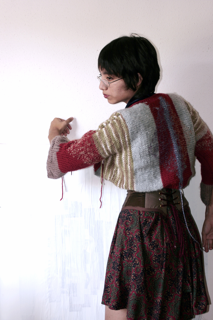 An old image of me with things I was making. I had to put in some makeshift boning in that corset so it warps a bit funny because it's just a brass piece in the back. This sweater was given to my mother, who loves to wear it. It was made with straight needles and stash yarn. Some was preciously handmade from Puebla, Mexico which I bought in 2007.