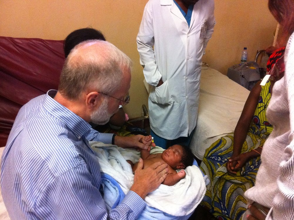 Dr. Phil Fischer evaluating a 4-day old infant in the Democratic Republic of the Congo