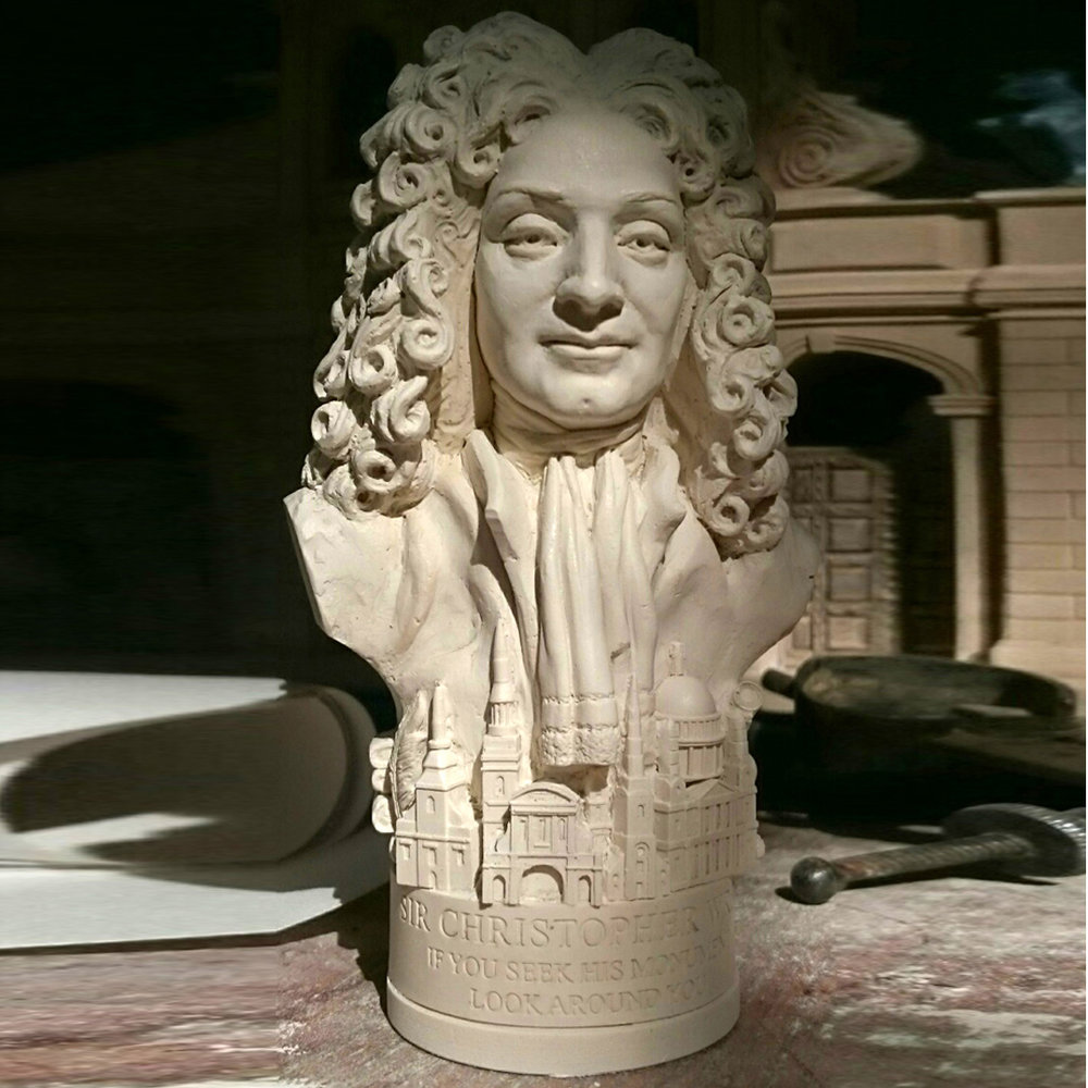 "Bust of Sir Christopher Wren £7.20 / RRP £18.00 (Height 13cm) Made in British Gypsum Plaster. Wren is best known as the architect of St. Paul's Cathedral and other London churches. As with all Famous Faces there are objects around the base. For this bust we have included the works of the great architect - St Brides, Temple Bar, St Paul's Cathedral. Also included are a nod to Wrens astrological talents with a telescope and rolls of plans and quill and ink. The etch around the base reads - ""IF YOU SEEK HIS MONUMENT LOOK AROUND YOU"""