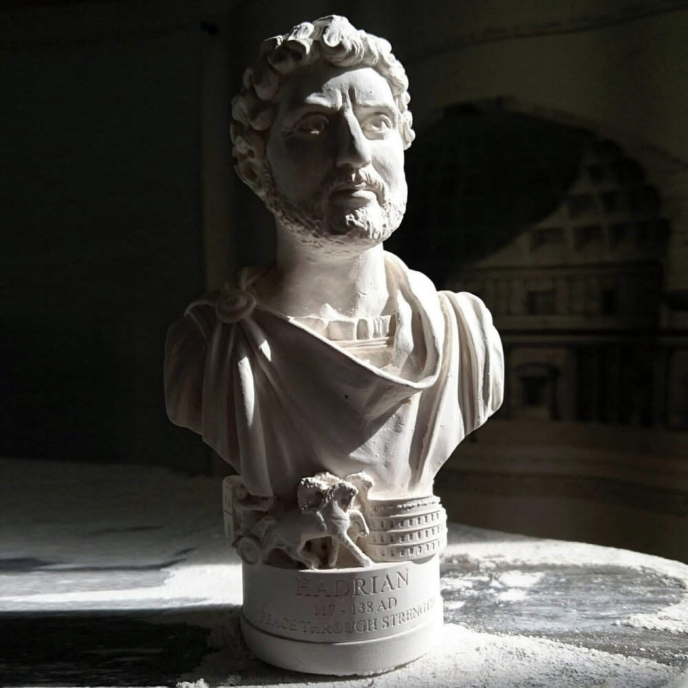 "Hadrian Bust £7.20 / RRP £18.00 (Height 13.5cm) Bust of Roman Emperor Hadrian made in British Gypsum Plaster. As with all Famous Faces there are objects around the base. For this bust we have included Hadrian's wall, a roman chariot, the Colosseum and Hadrian's Arch. The etch around the base reads - ""PEACE THROUGH STRENGTH"""